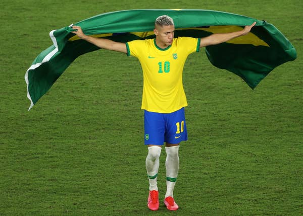 Brazil soccer star Richarlison draped in Brazil flag