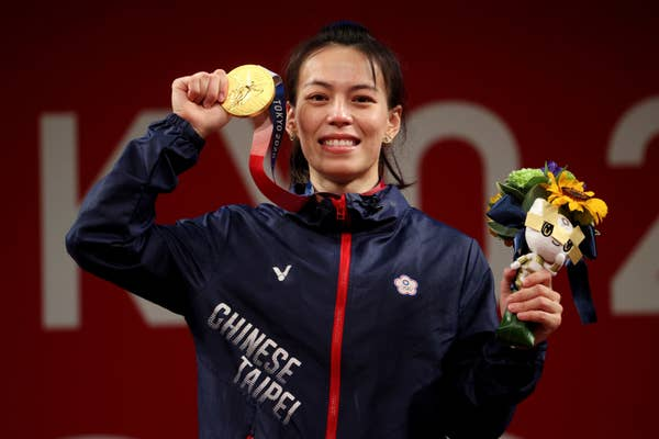 Hsing-Chun Kuo of Team Chinese Taipei poses with the gold medal