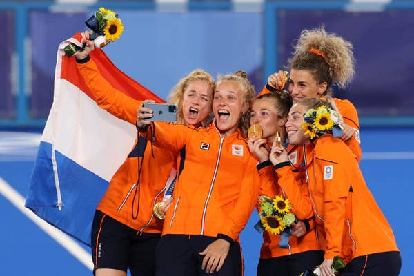 Team Netherlands pose for a selfie with their Gold Medals