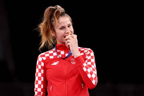 Matea Jelic of Team Croatia poses with the gold medal by biting it
