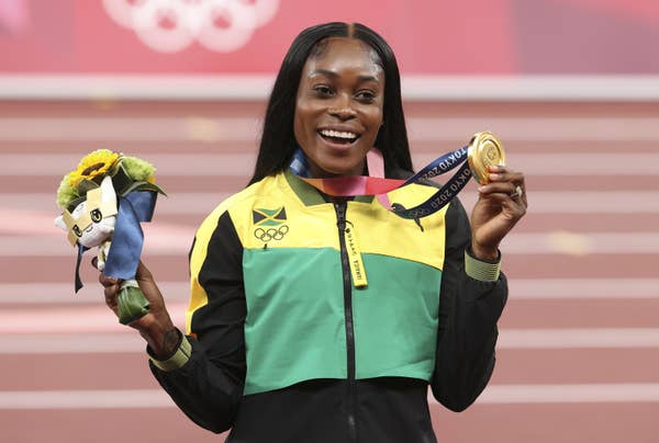 Elaine Thompson-Herah poses with gold medal
