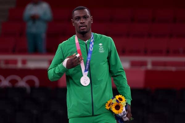 Tareg Hamedi of Team Saudi Arabia poses with the silver medal