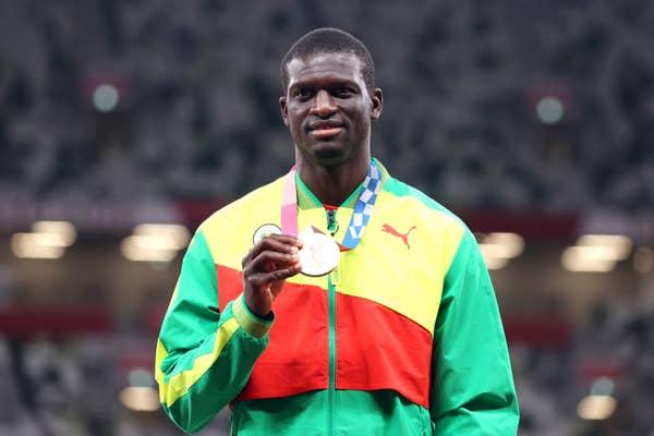 Grenada's Kirani James holds bronze medal for Men's 400m.