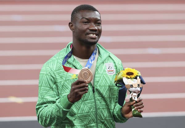 Hugues Fabrice Zango holds bronze medal for Men's Triple Jump