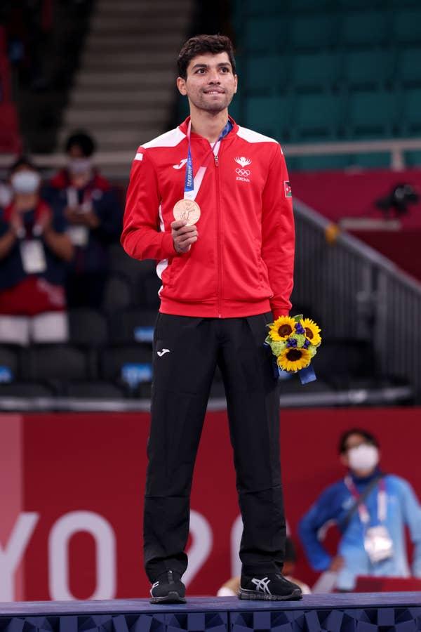 Abdel Rahman Almasatfa of Team Jordan poses with the bronze medal