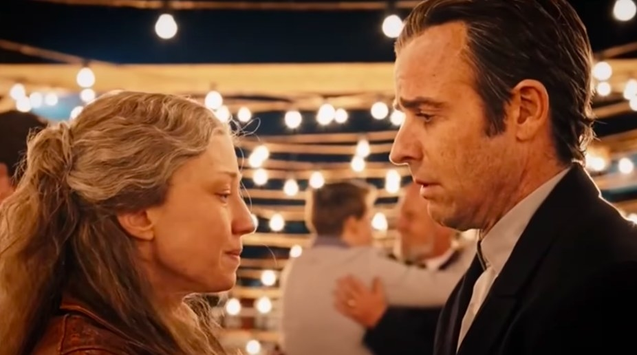 An old Nora and Kevin look at each other emotionally on a dance floor