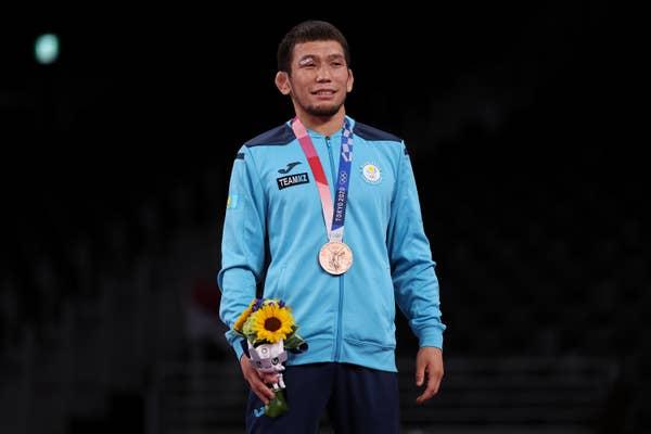 Nurislam Sanayev of Team Kazakhstan poses with bronze medal