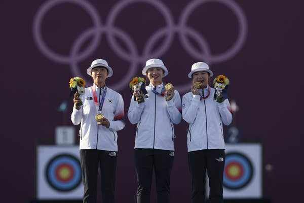 San An, Minhee Jang, and Chaeyoung Kang of Team South Korea pose with their gold medals