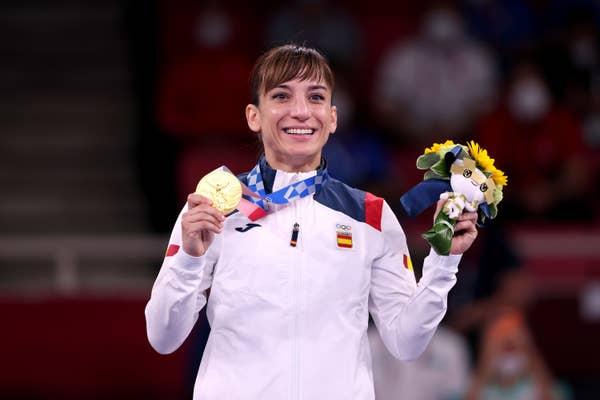 Spain's Sandra Sanchez Jaime poses with gold medal