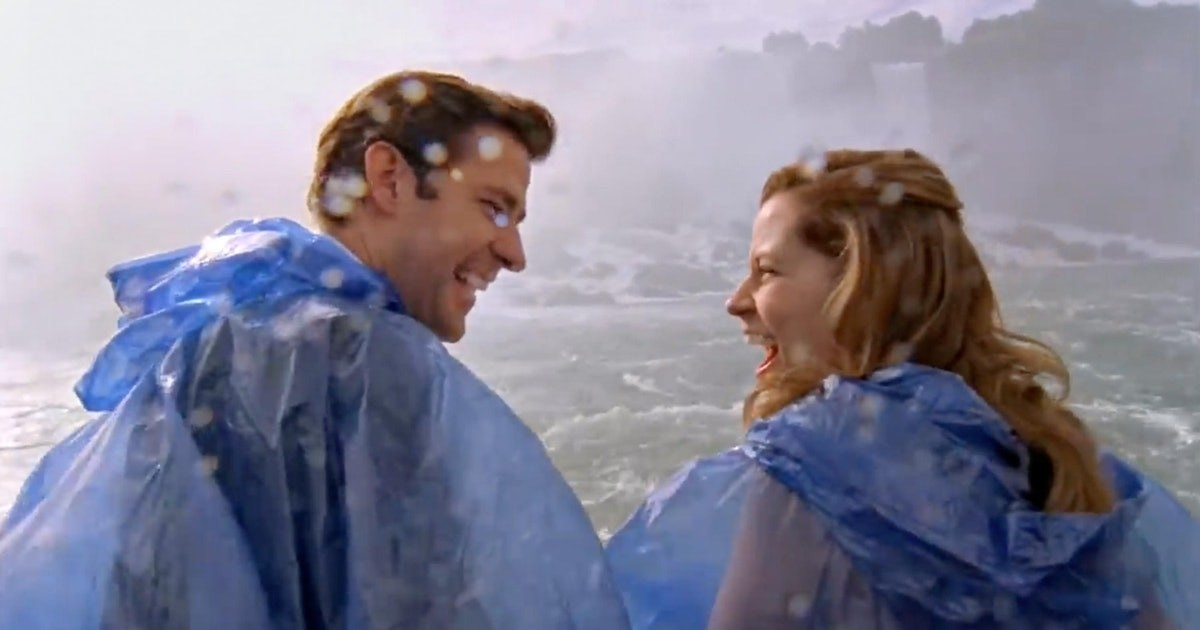 Jim and Pam smile at each other in excitement at Niagara Falls
