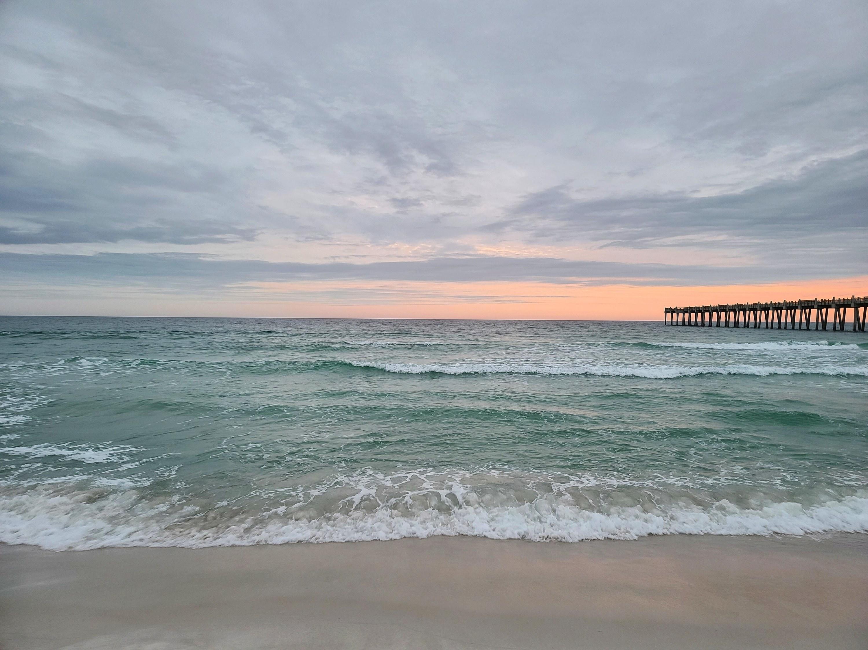 A wave crashes onto a beach of Gulf Islands seashore.