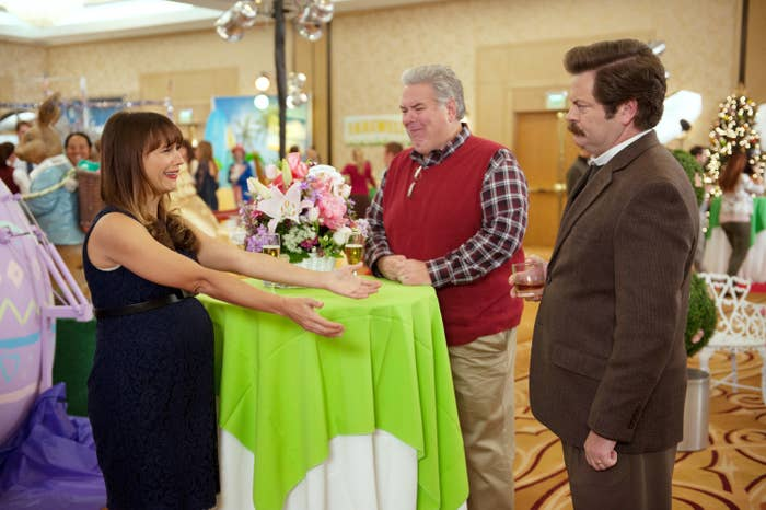 Ann Perkins reaching out to embrace Ron Swanson