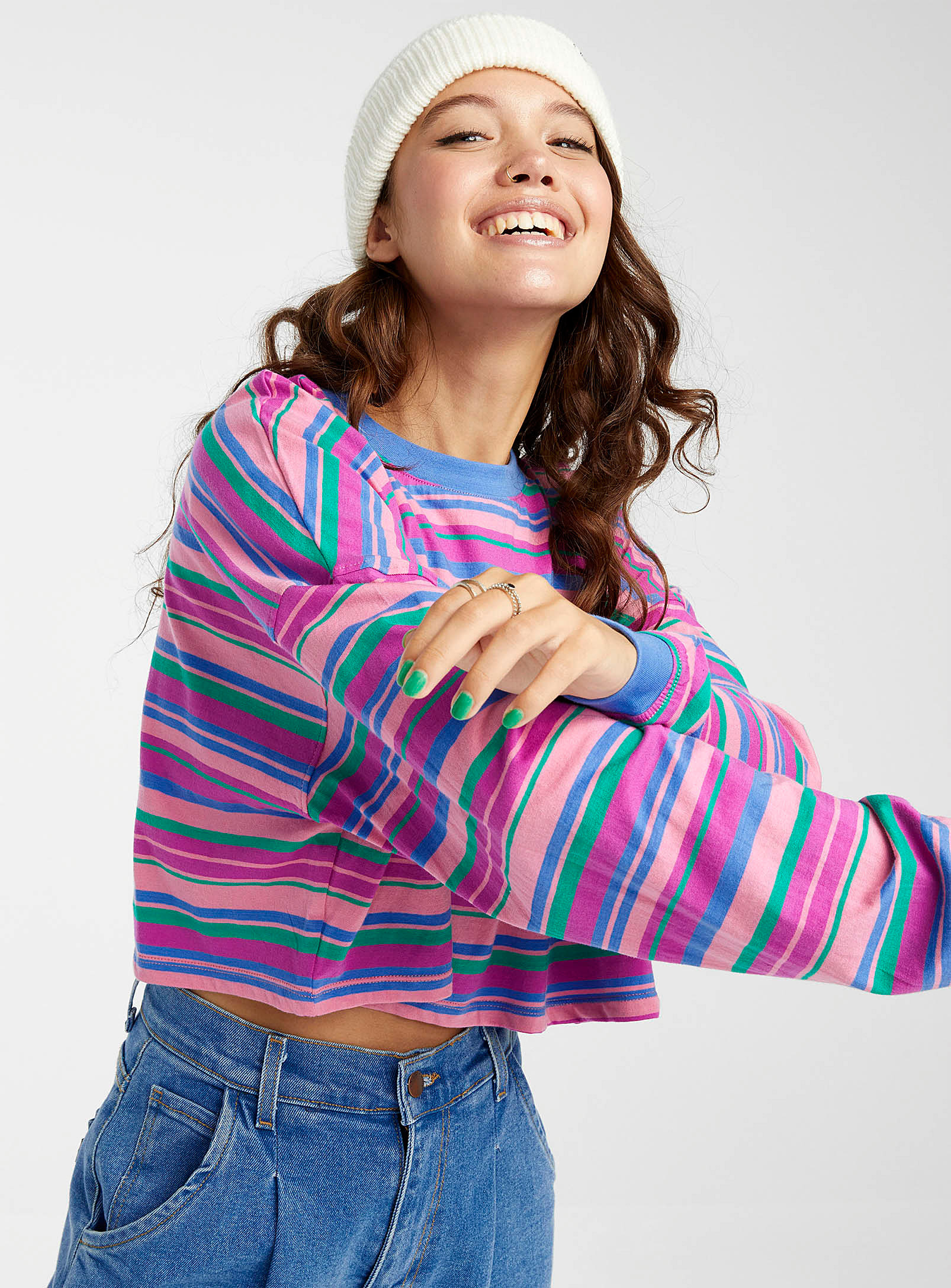 a person wearing the striped crew neck with a pair of jeans