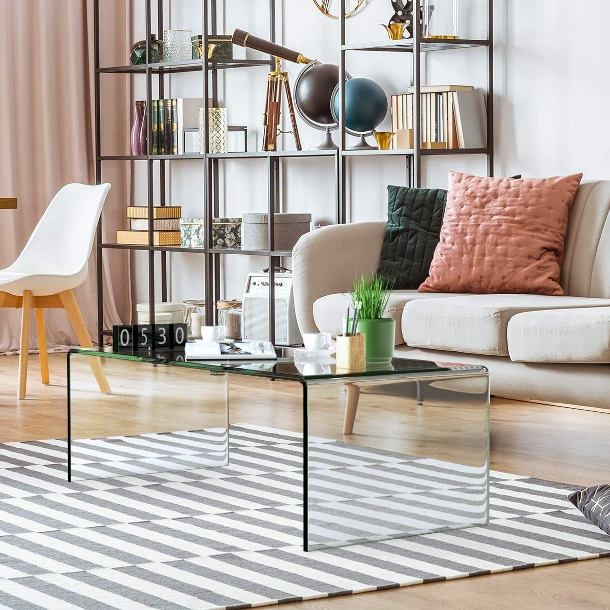 The coffee table with decor accessories on it in a living room