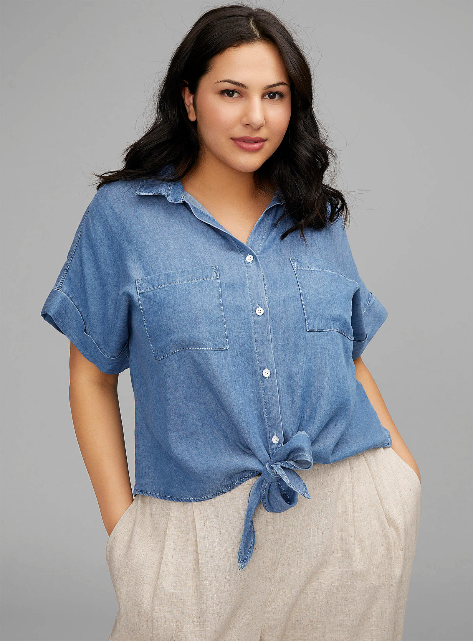 a person wearing the tie-up denim t-shirt with linen pants