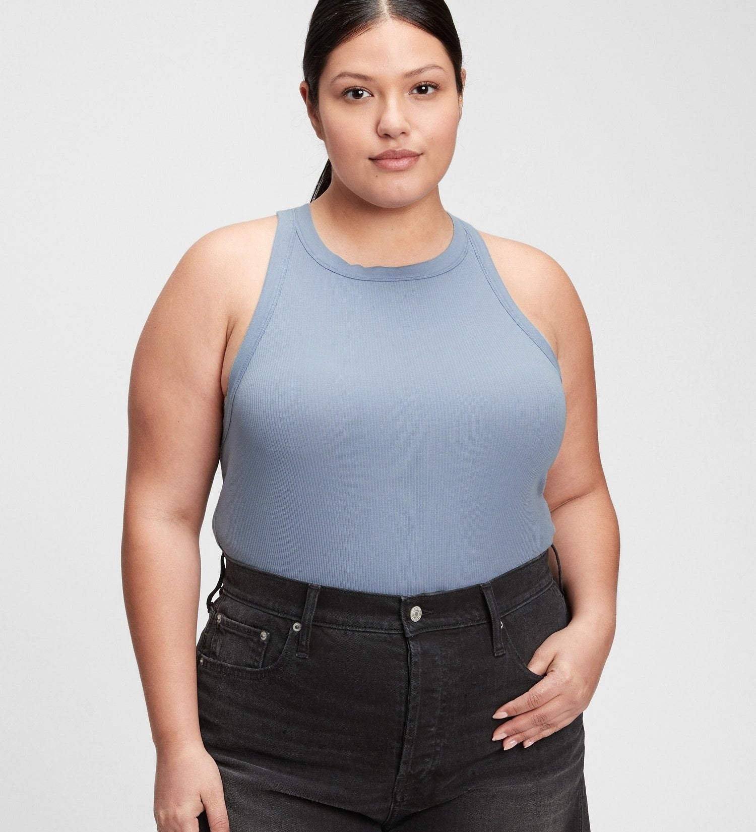 a person wearing the tank with a pair of jeans