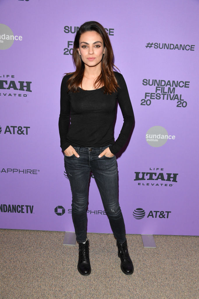 """Mila Kunis wears a black shirt with matching combat boots and jeans to the 2020 Sundance Film Festival premiere of """"Four Good Days"""""""