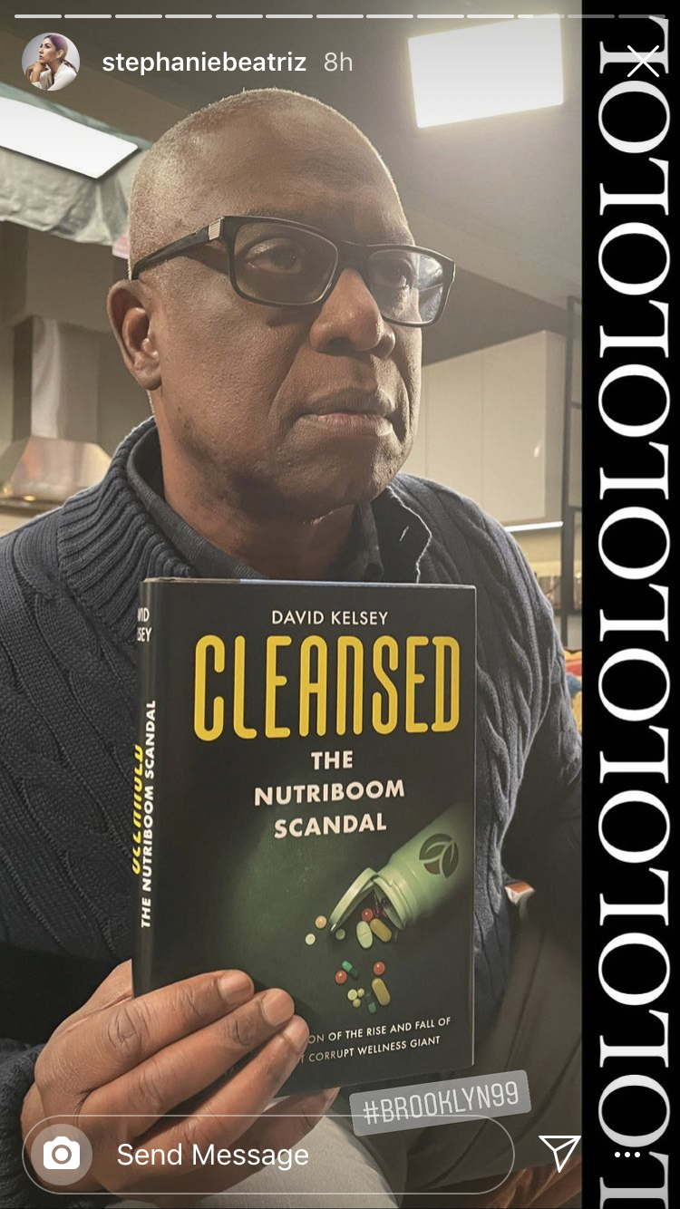 Andre holding a book about the Nutriboom scandal