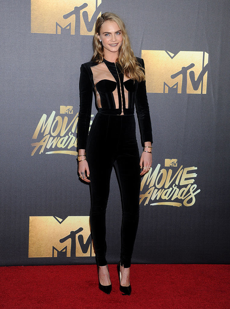 fitted velvet jumpsuit with geometric cutouts at top