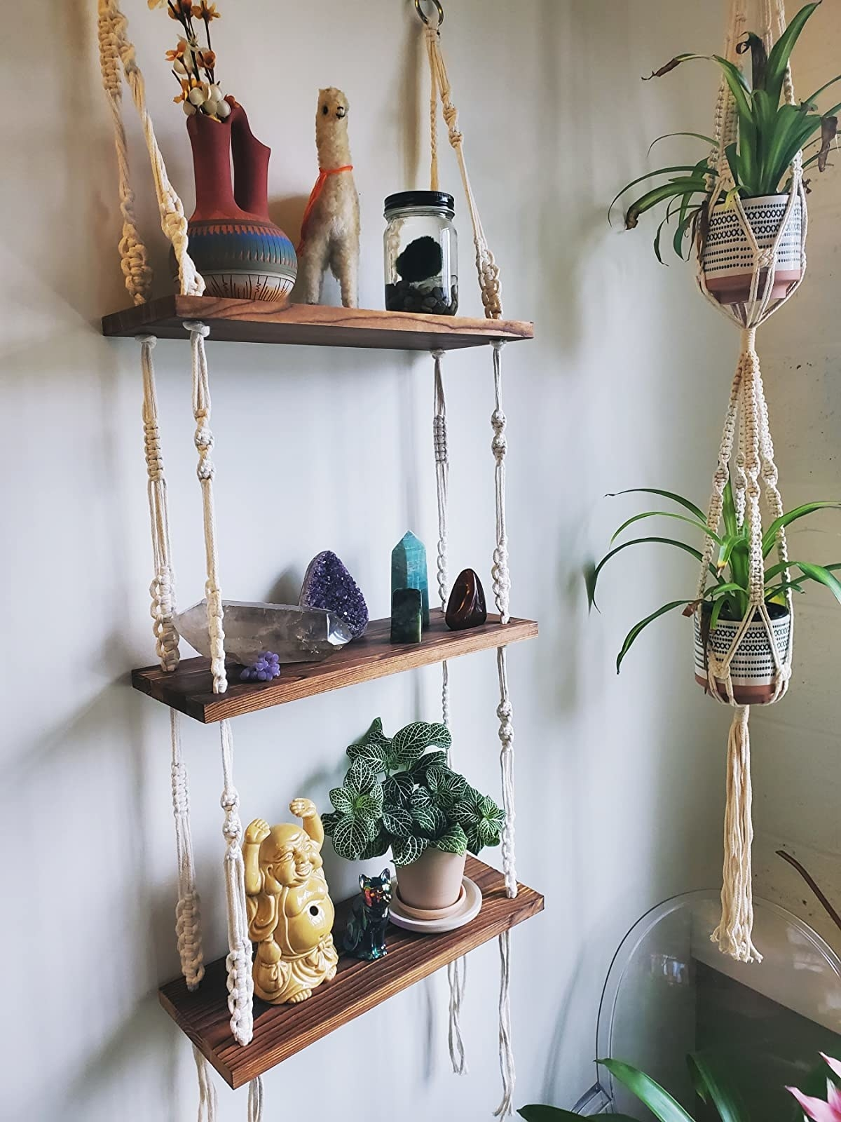 Reviewer's hanging shelves house small nicknames like crystals, plants, and figurines