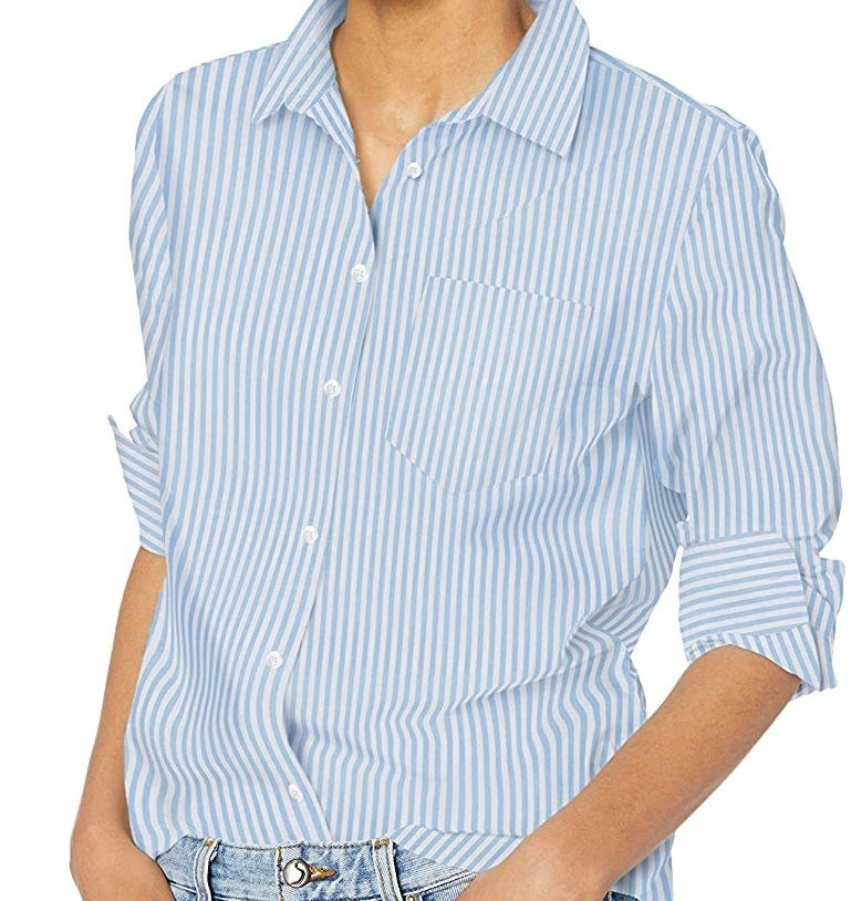 a person wearing the striped dress shirt tucked into jeans
