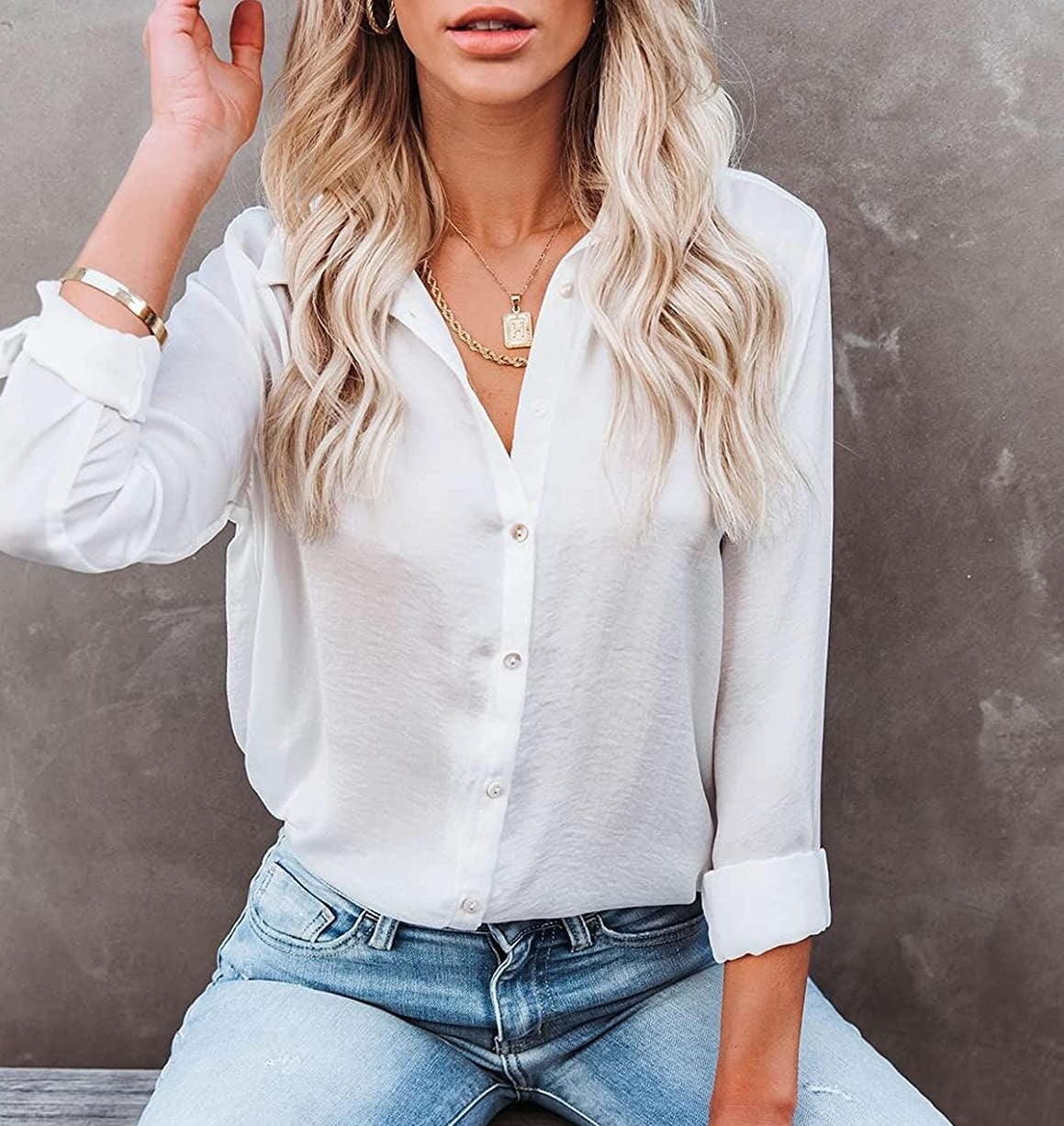 a person wearing the blouse with jeans