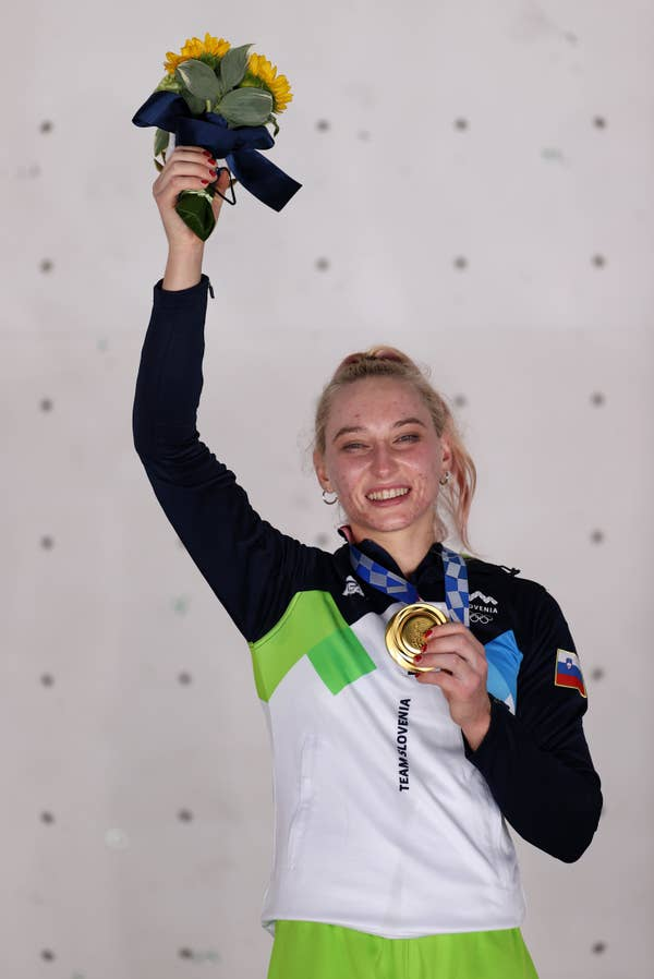 Janja Garnbret of Team Slovenia poses with the gold medal for Sport Climbing