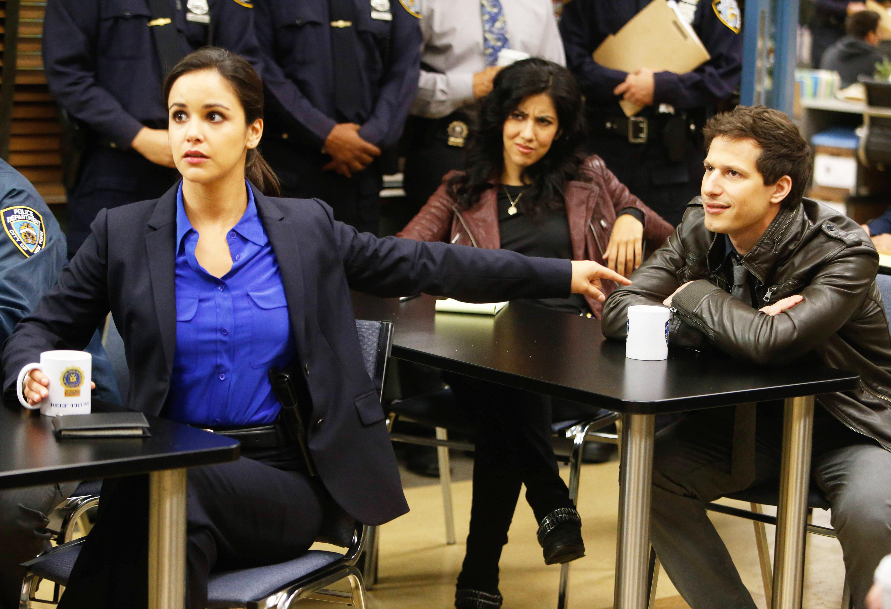 Amy Santiago, looking frightened, points at Jake