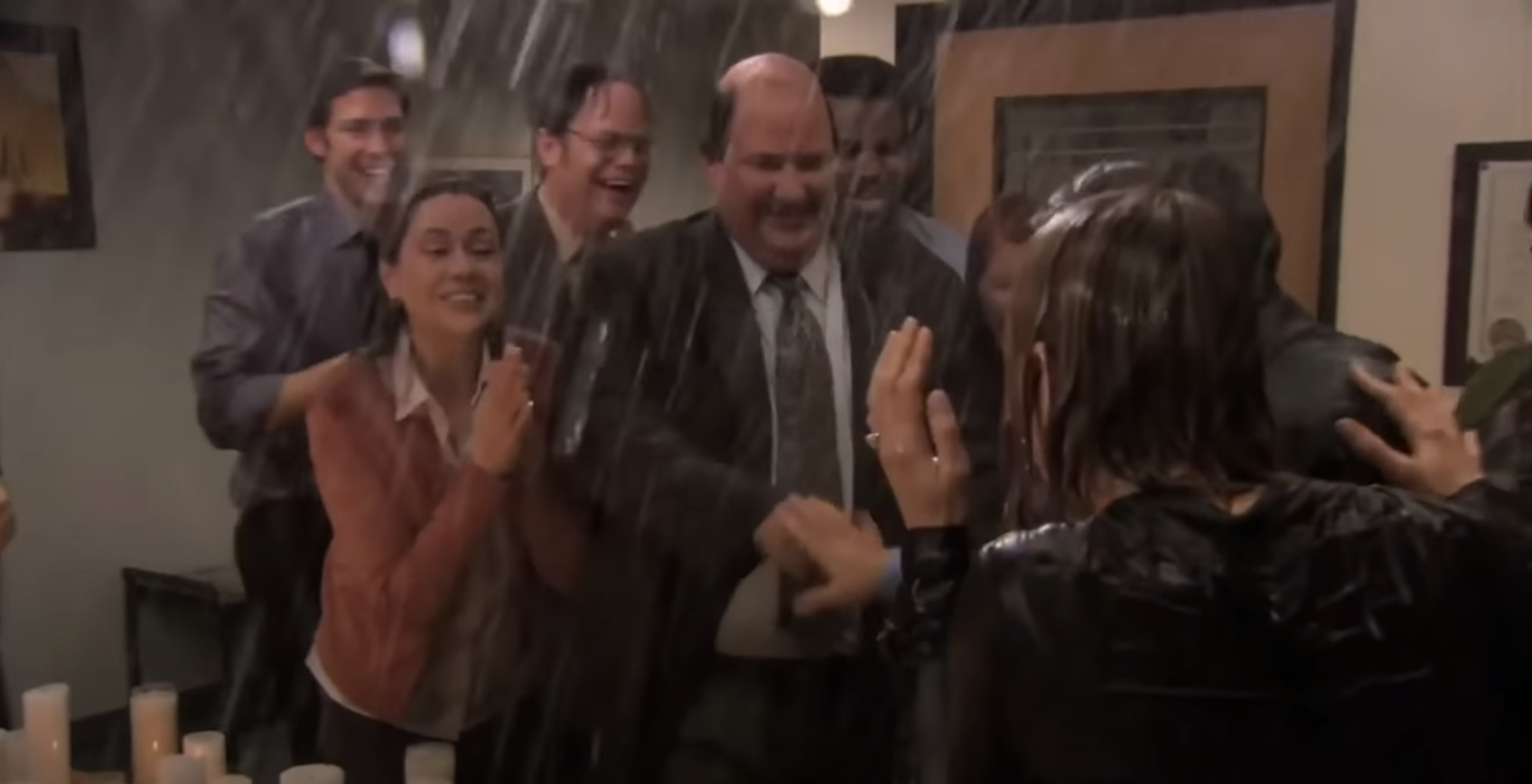 Soaked but excited Dunder Mifflin employees cheer to celebrate the proposal