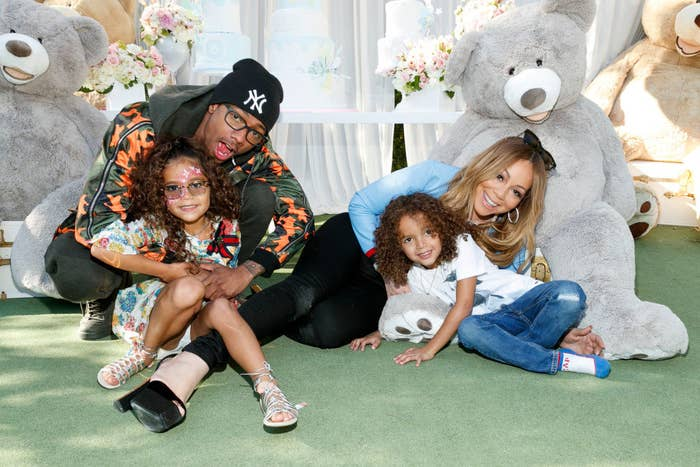 Nick Cannon posing for a photo with Mariah Carey and their twins