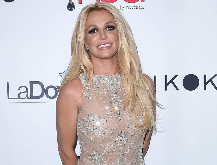 Britney smiles in an nude colored dress with crystal embellishment