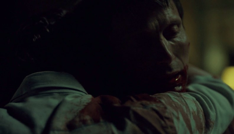 Hannibal embraces Will; they're both covered in blood