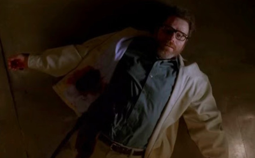 Walter lays on the ground with a bloody jacket