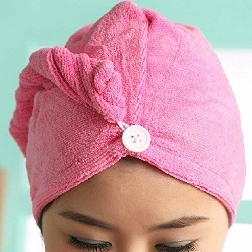 A person wearing microfibre towel on her head.