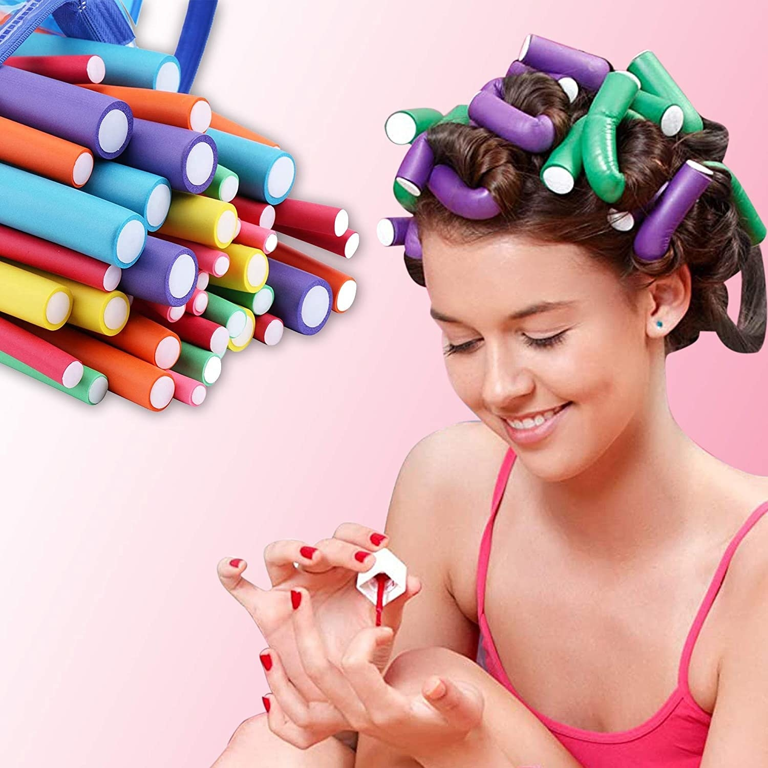 A person wearing curling rods on their hair while applying nail paint.