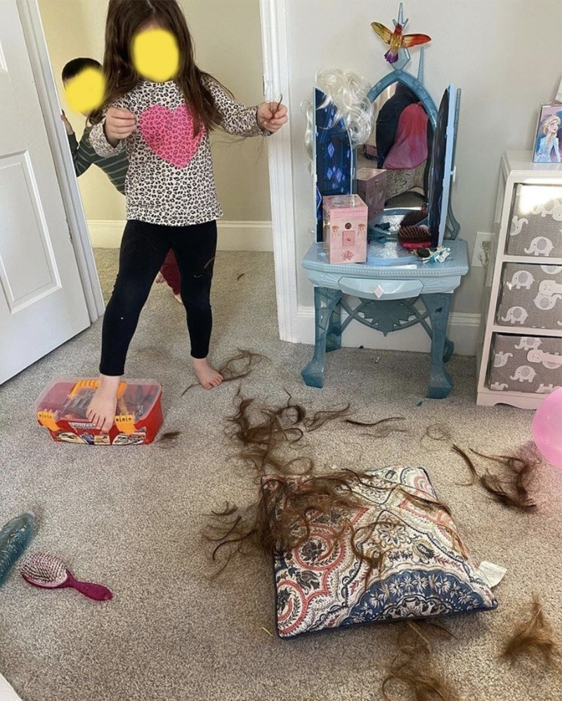 photo of kids with hair all over the floor