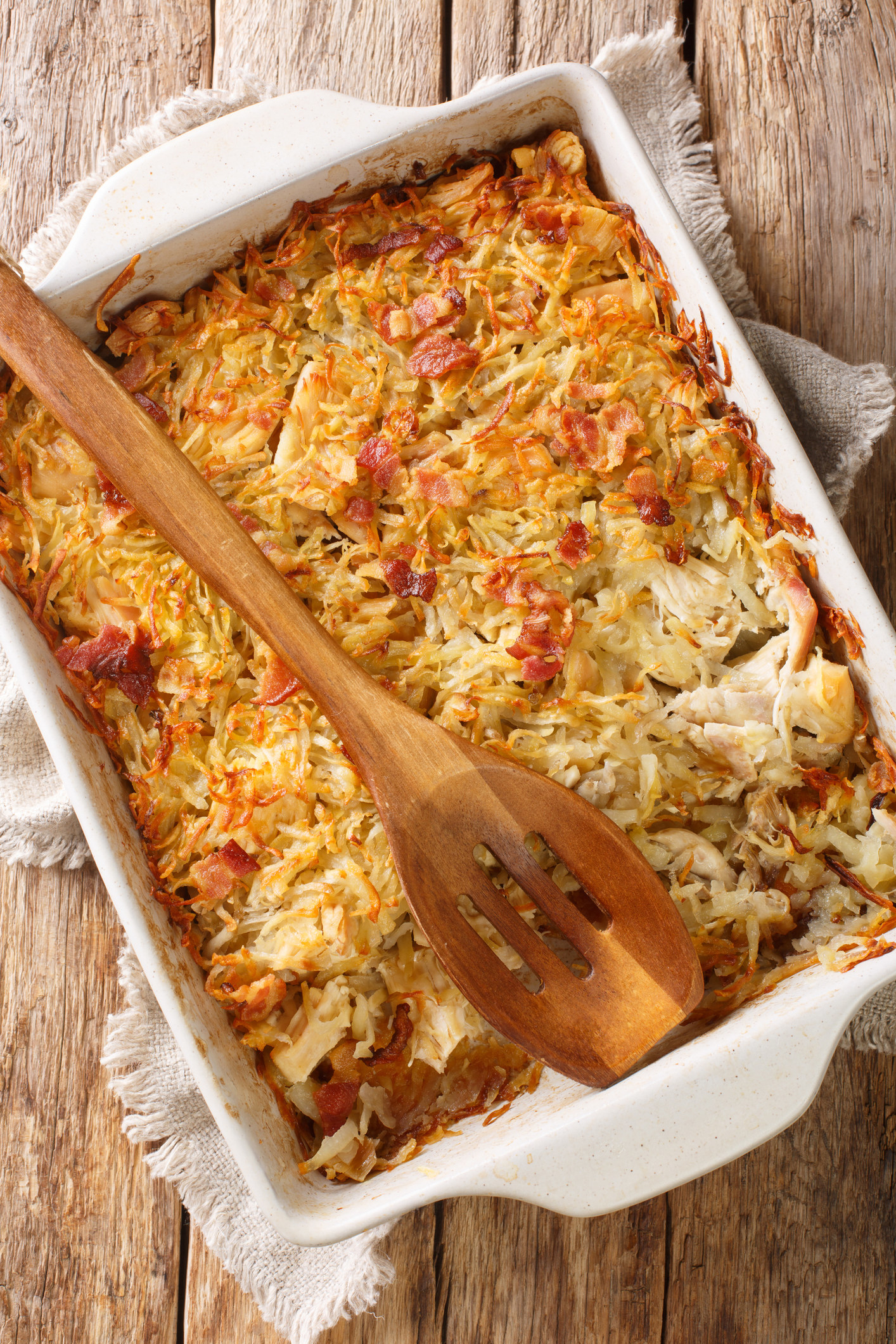 Photo of a cooked potato-chicken mix in a casserole dish.