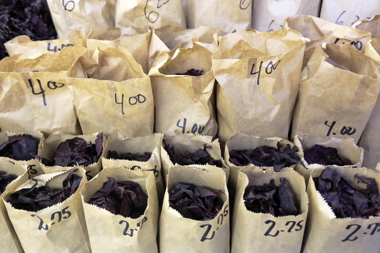 Several paper bags of fresh Dulse for sale in Saint John City Market