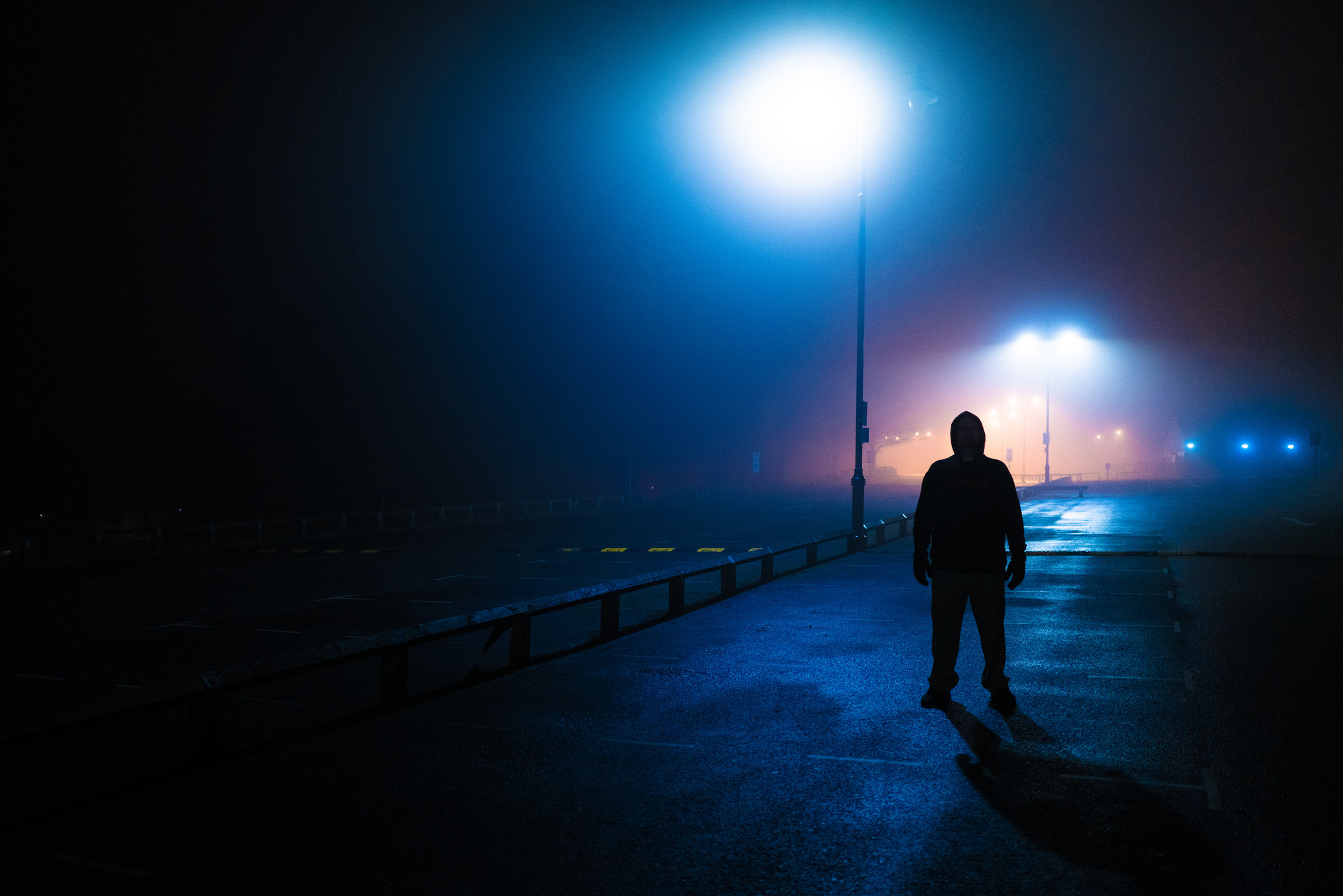 A person lurking on a dark road