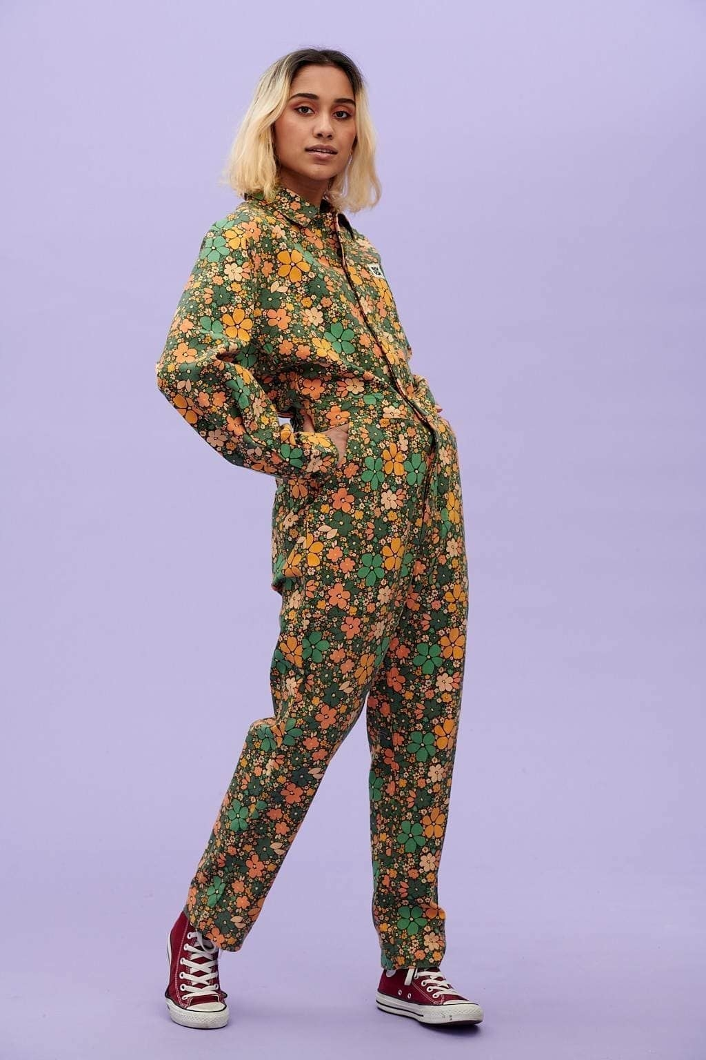 a model wearing the carmen organic cotton boilersuit in floral tay print