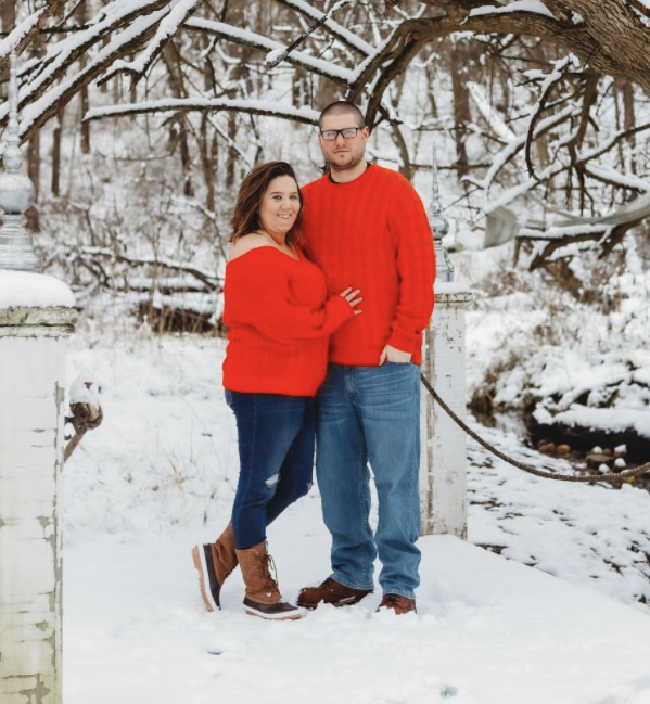 Two people wearing the sweater