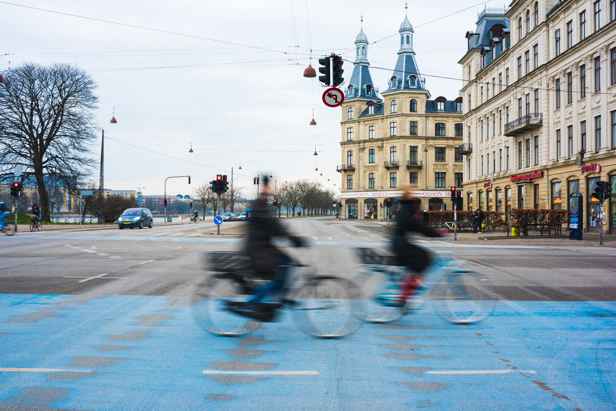 People bike riding in Copenhagen.