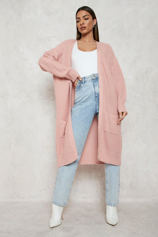 model wearing the pink cardigan