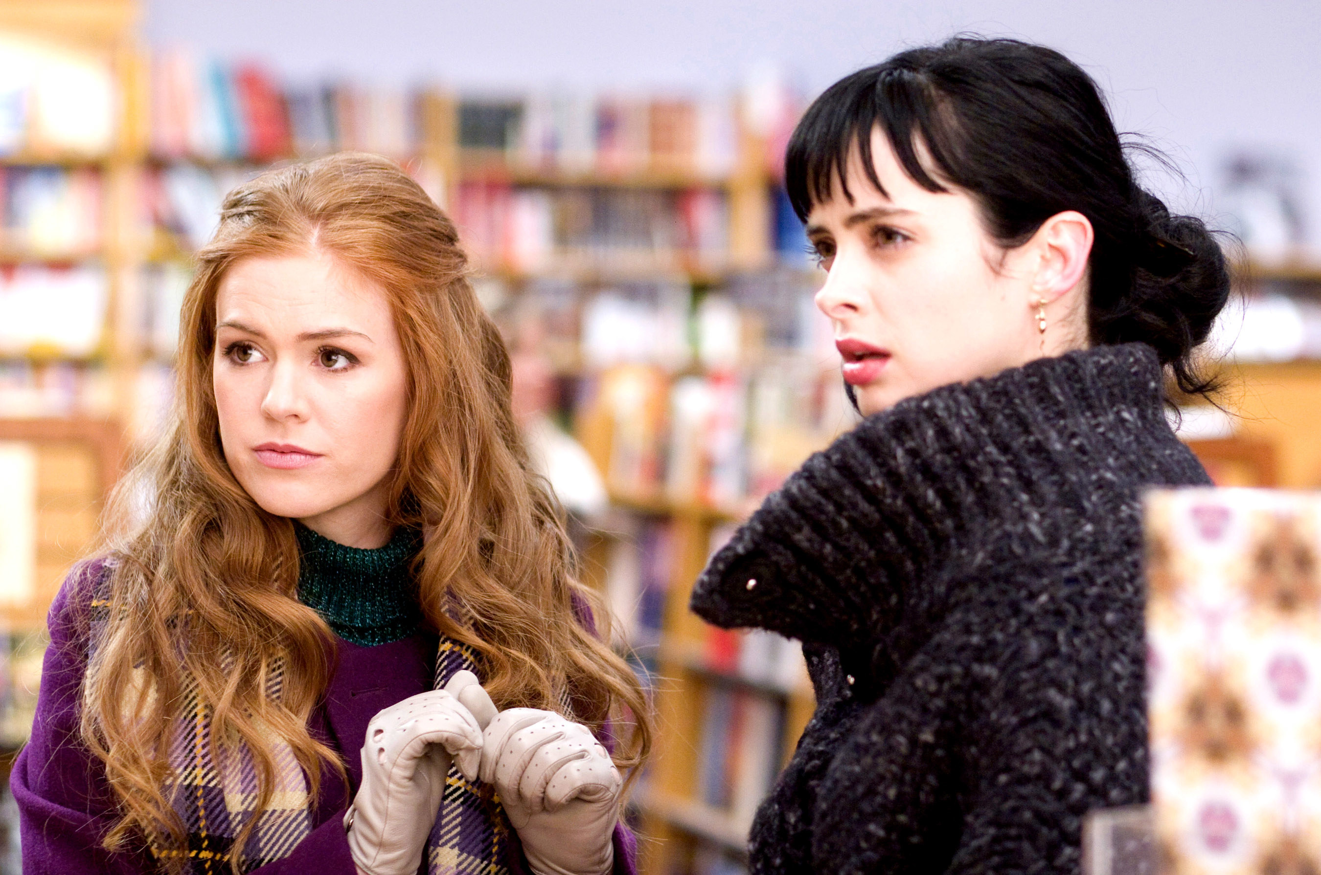 Isla Fisher and Krysten Ritter look concerned.