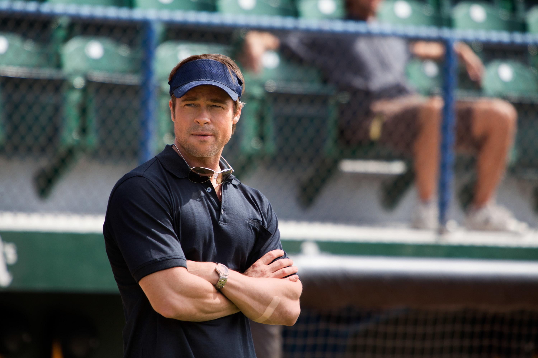 Brad Pitt on the sidelines of the baseball field