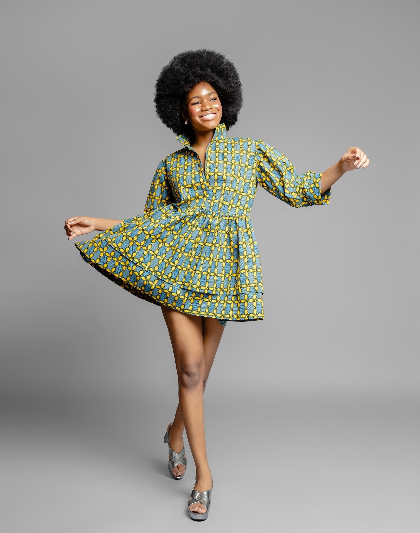 model wearing the 3/4-sleeve green and yellow mini dress