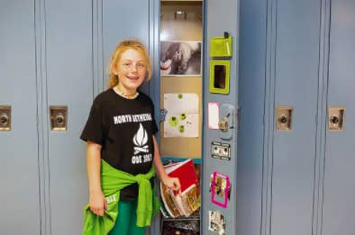 a young student by her decorated locker