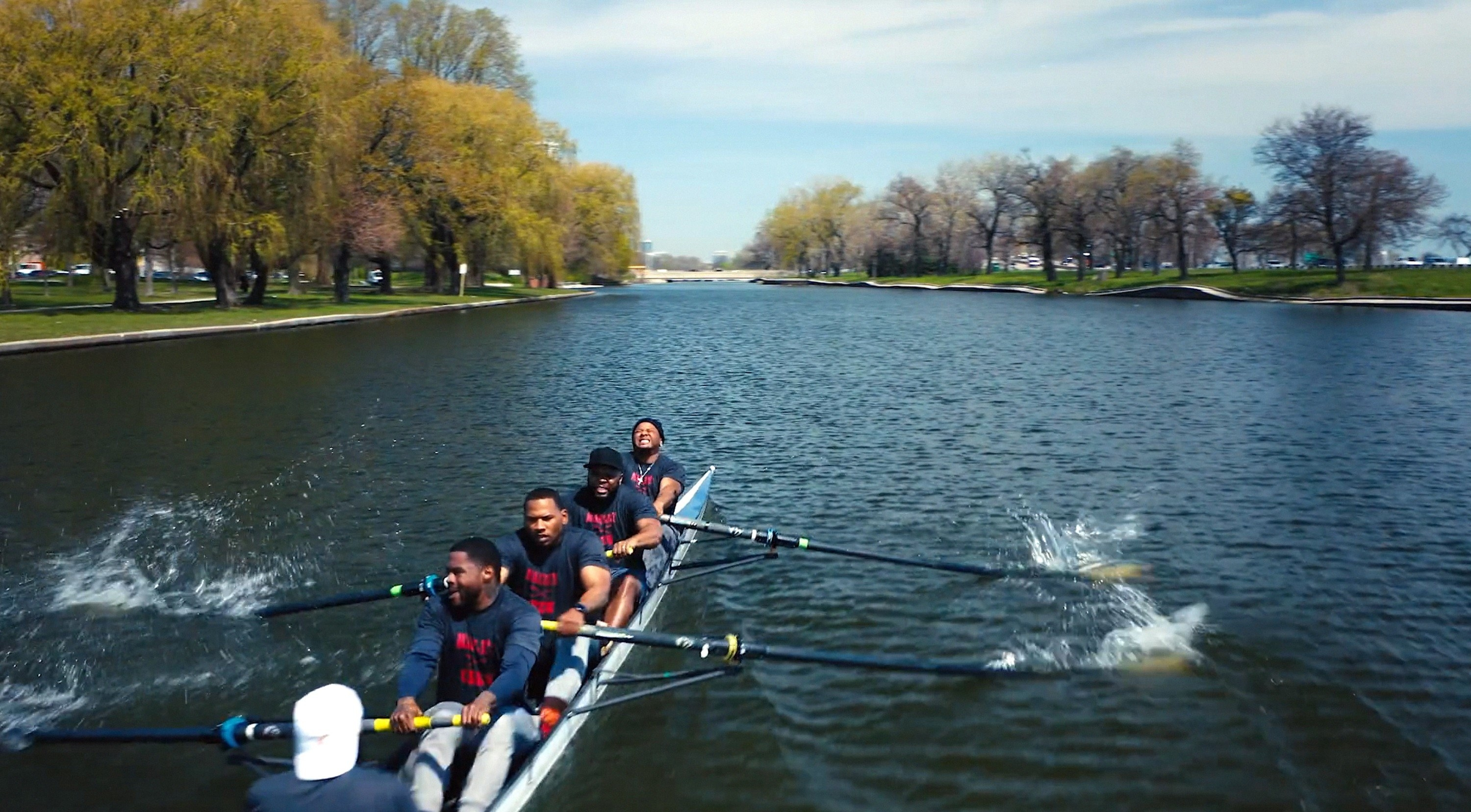 The Manley High rowing team rowing in the lake