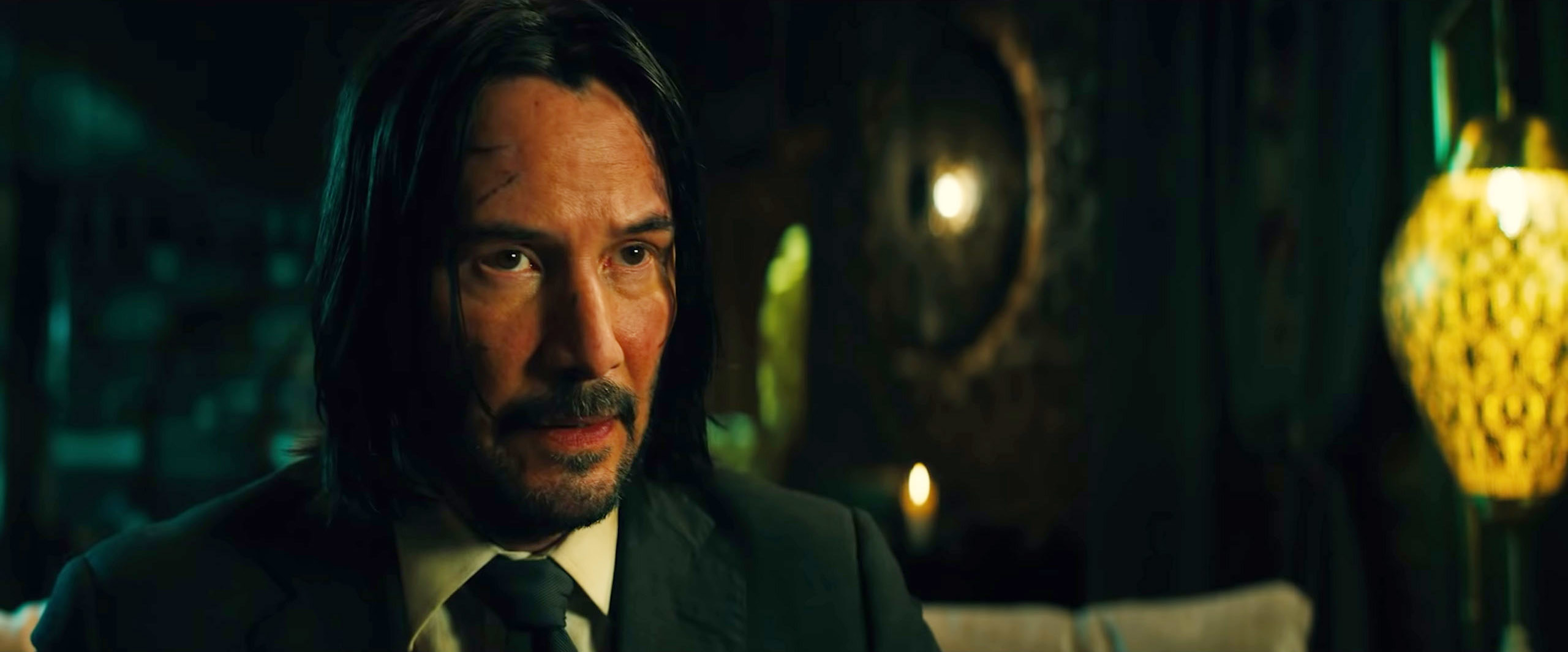 Keanu Reeves as John Wick with a bloodied face