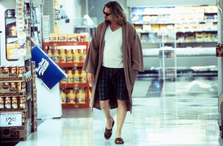 Jeff Bridges as The Dude, walking through a supermarket